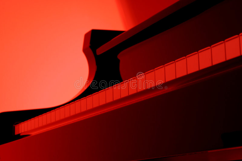 Piano in rood stock foto's