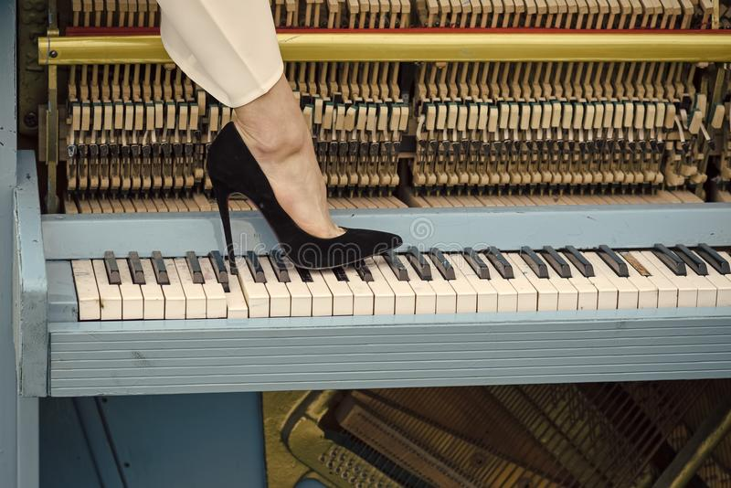 Piano and legs, musical style, grunge instrument. stock image
