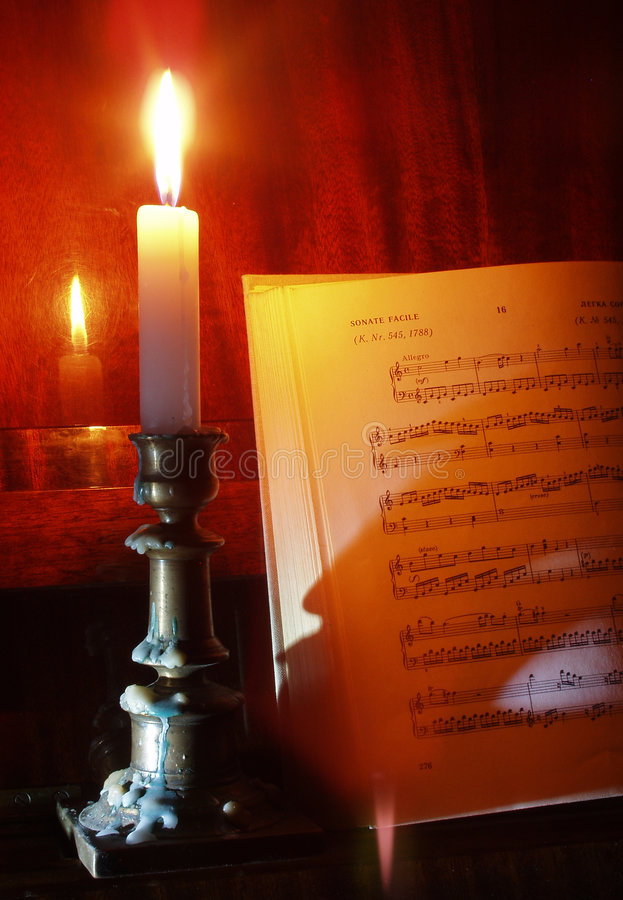 Download Piano And Sheet Music In The Candle Lighting Stock Photo - Image: 500408