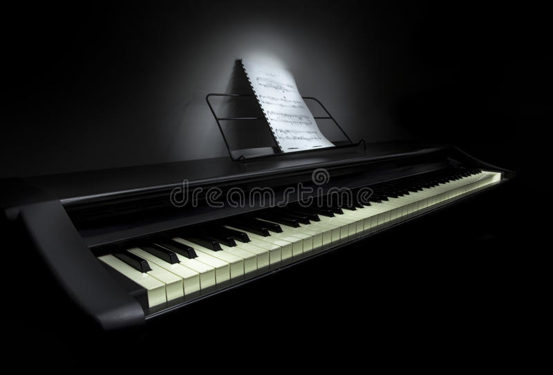 Piano with sheet music royalty free stock images
