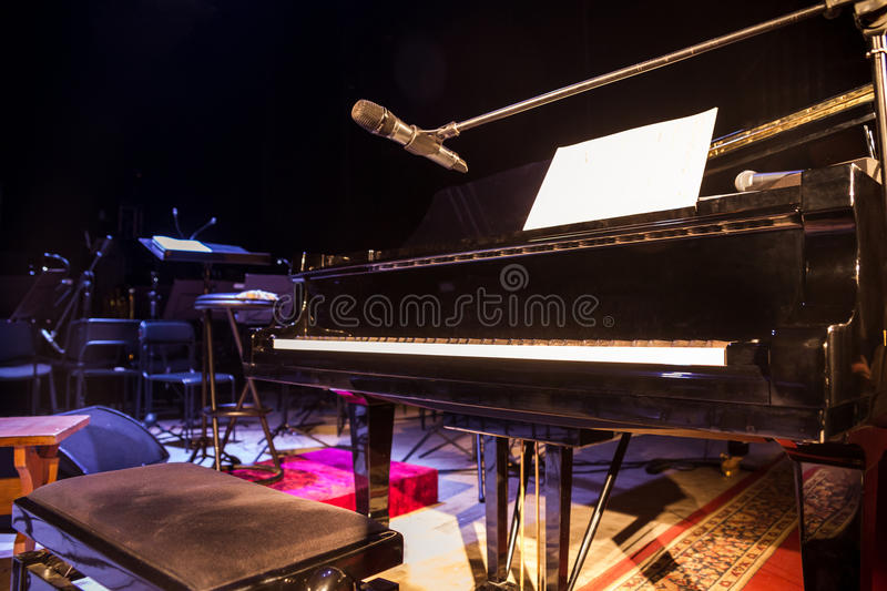 Piano on stage.Empty chairs stand on stage in Concert Hall. Scene symphony concert hall.European scene, a concert of symphonic mu royalty free stock photography