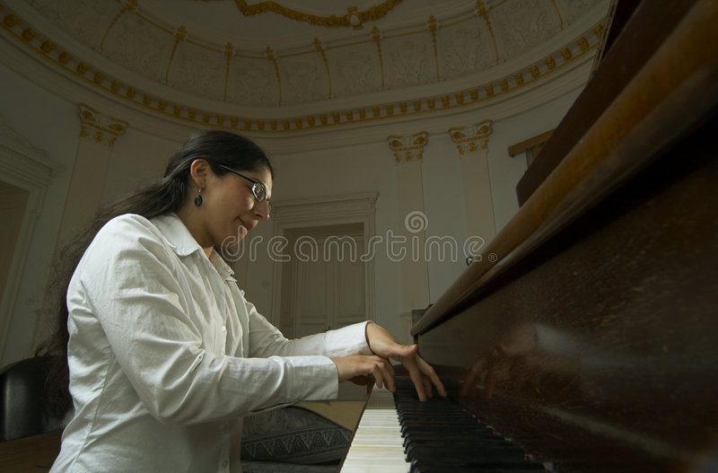 Piano Teacher Playing Low Viewpoint royalty free stock images