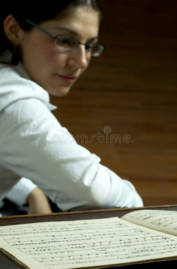 Piano Teacher Reading Music stock photos