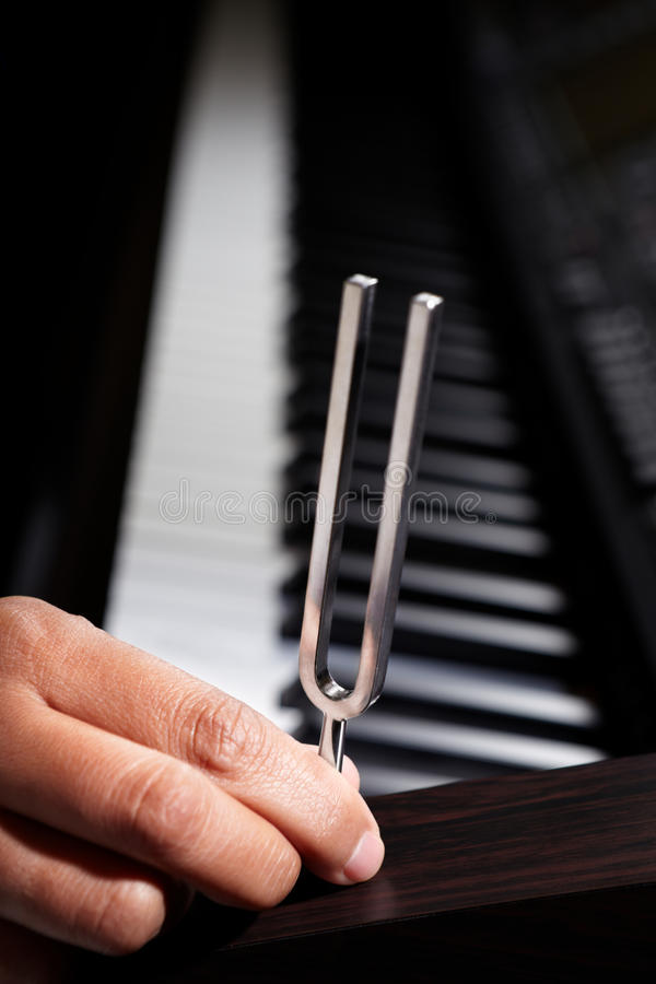 Piano and tuning fork royalty free stock images