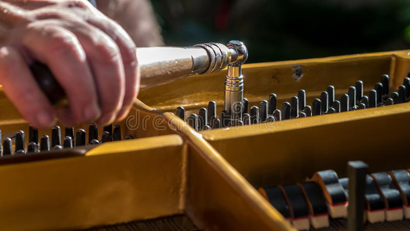 Piano tuning royalty free stock photography