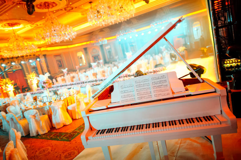 Piano at wedding. Set for dinner royalty free stock photography