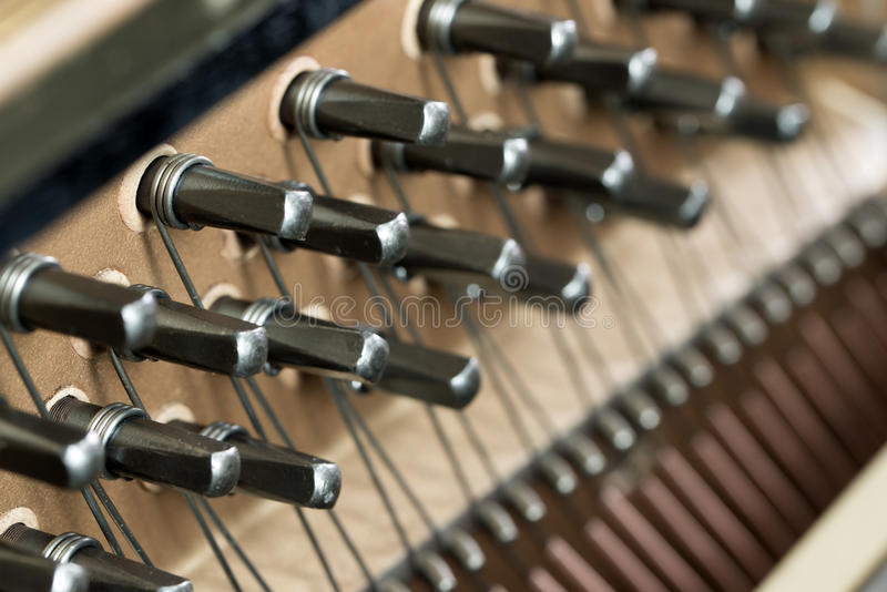 Piano wire. Close up of piano strings forming background royalty free stock image