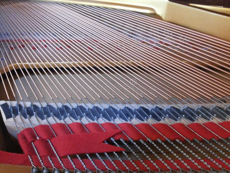 Piano wire. Commonly used piano solo, ensemble, accompaniment and other performances, composing and rehearsing the music is very convenient. Player by pressing a stock photography