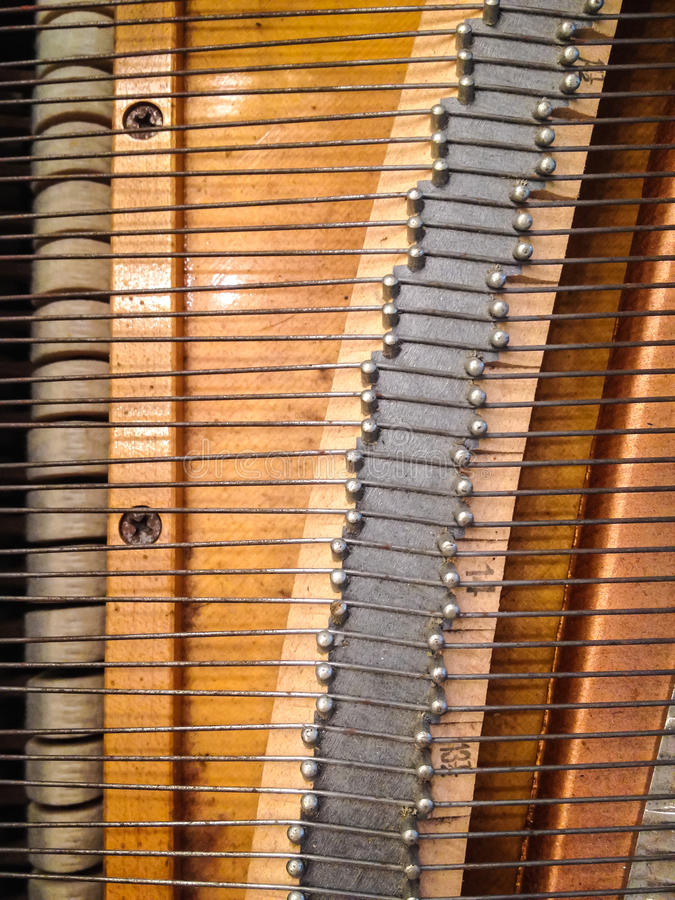 Piano Wire. Hammer and wire inside the grand piano royalty free stock photos