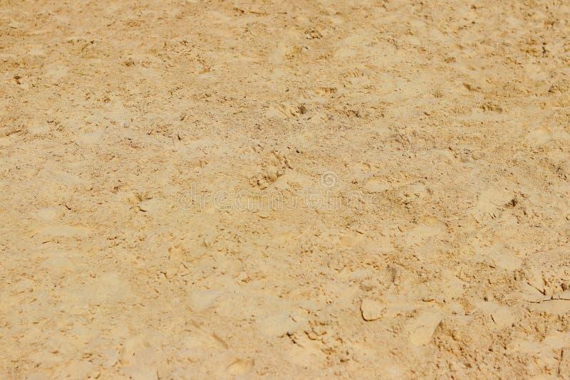 Piasek ulga dryluje teksturę chaotyczni odciski stopy Naturale tła koloru żółtego pustyni ziemia Dekoracja budynki i krajobraz obrazy royalty free