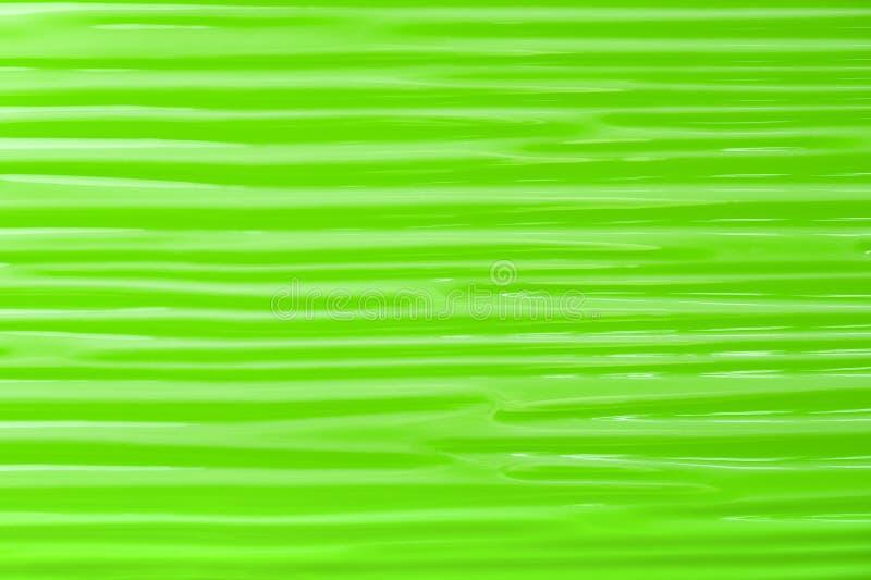 Piastrella di ceramica ondulata astratta verde del fondo fotografie stock