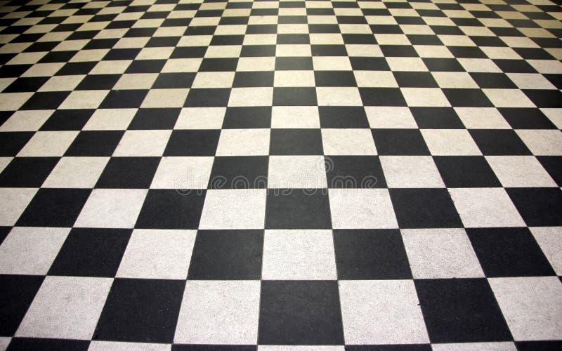 Piastrelle per pavimento in bianco e nero immagini stock