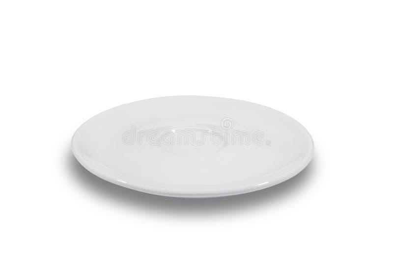 Piattino bianco piano su fondo bianco dal lato fotografia stock