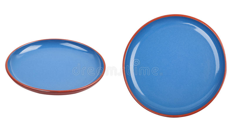 Piatto ceramico blu isolato su fondo bianco fotografia stock libera da diritti