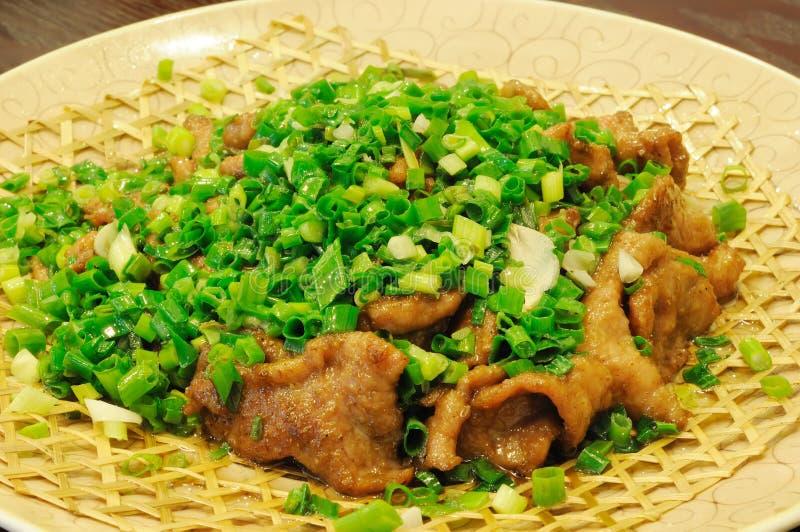 Piatto cinese del manzo di cucina con la cipolla immagini stock