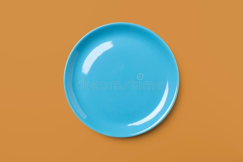 Piatto colorato pastello blu su fondo complementare, immagine stock libera da diritti