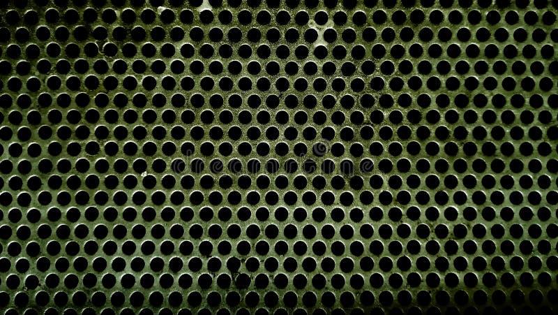 Piatto del ferro con piccola struttura regolare dei fori fotografie stock