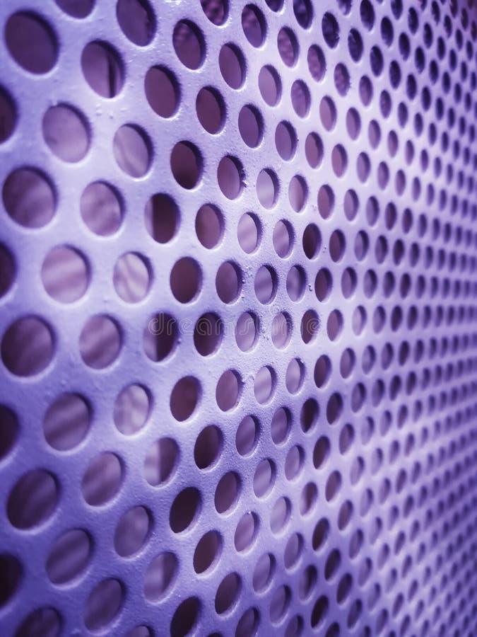 Piatto del ferro con piccola struttura regolare dei fori immagini stock