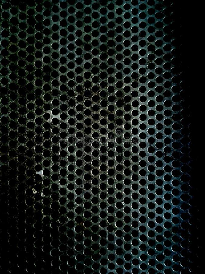 Piatto del ferro con piccola struttura regolare dei fori immagine stock libera da diritti