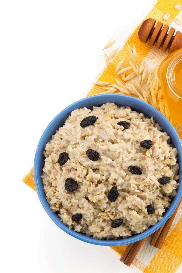 Piatto della farina d'avena su bianco immagine stock libera da diritti