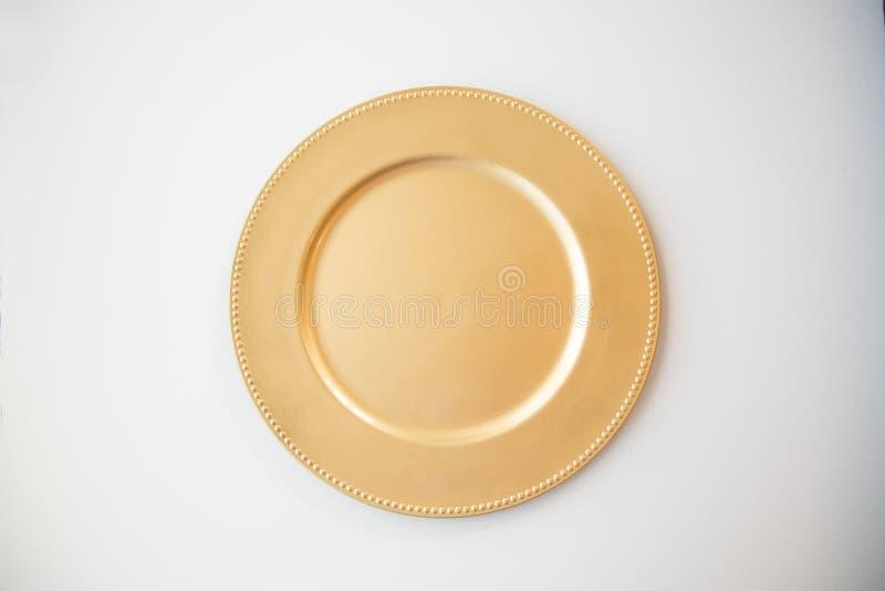 Piatto di oro immagini stock libere da diritti
