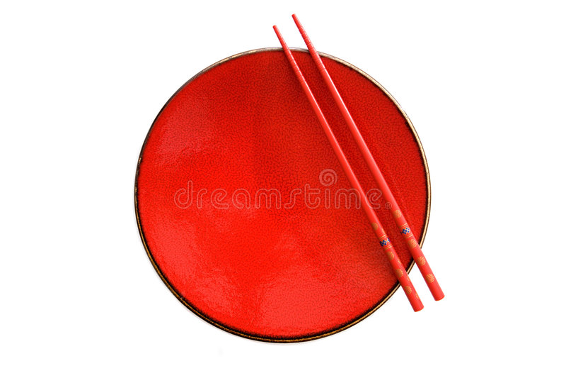 Piatto e bacchette rossi con stile orientale immagini stock libere da diritti