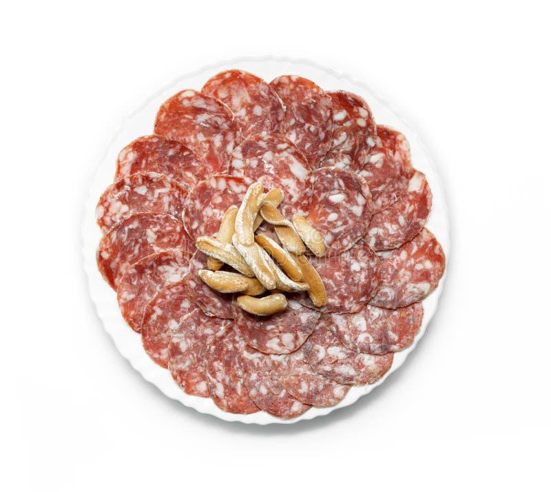 Piatto iberico tradizionale Salchichon Iberico della salsiccia del salame immagini stock libere da diritti