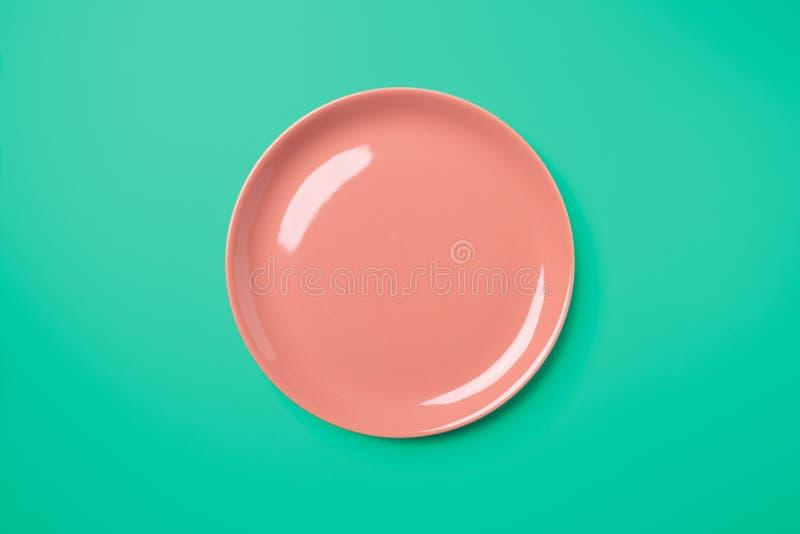 Piatto pastello di Rosa su fondo verde complementare fotografia stock