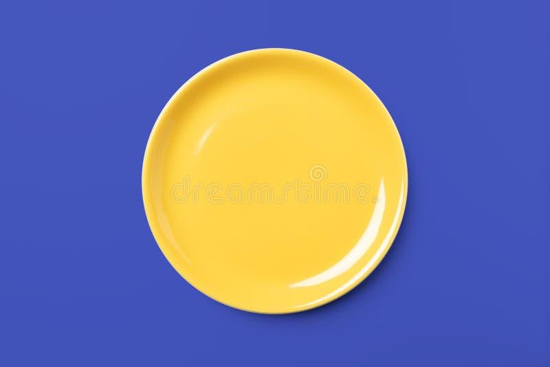 Piatto pastello giallo su fondo blu complementare fotografia stock libera da diritti