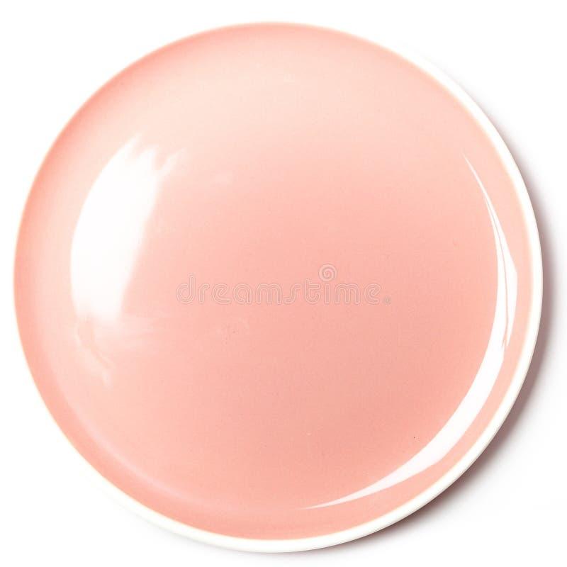 Piatto rosa pastello vuoto su fondo bianco fotografia stock