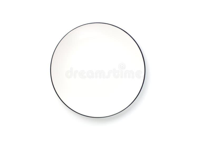 Piatto rotondo bianco vuoto con il confine nero Copi lo spazio Vista superiore fotografia stock