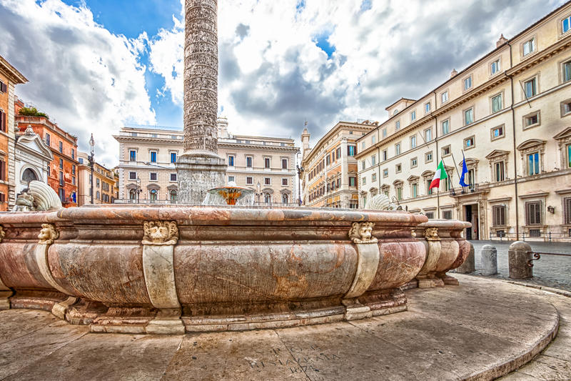 Piazza Colonna Rome. Close up of fountain located in Piazza Colonna next to the Column of Marcus Aurelius. The square is located in Via del Corso, close to royalty free stock photos