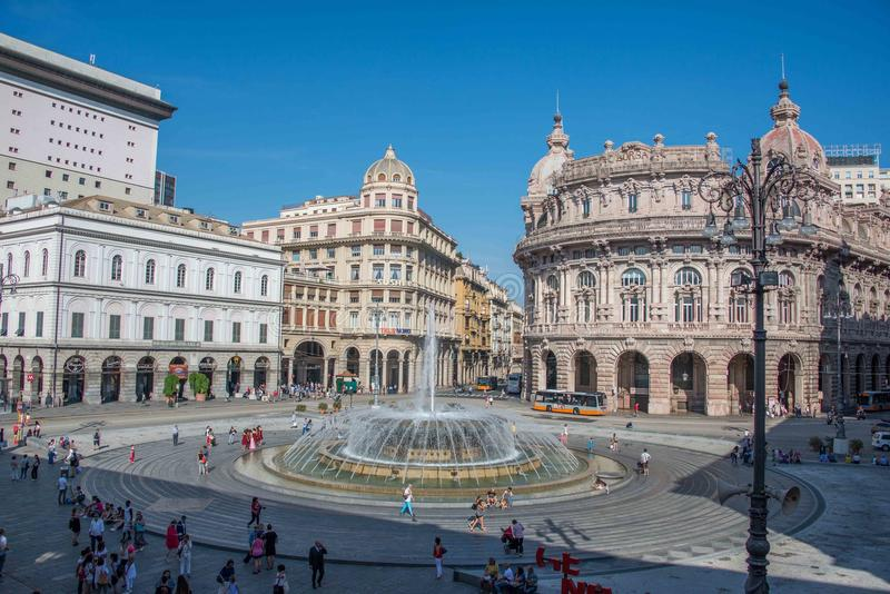 Piazza de Ferrari in Genoa. Italy the very center of the city. The Academy of fine arts and banks in front of the fountain royalty free stock photo