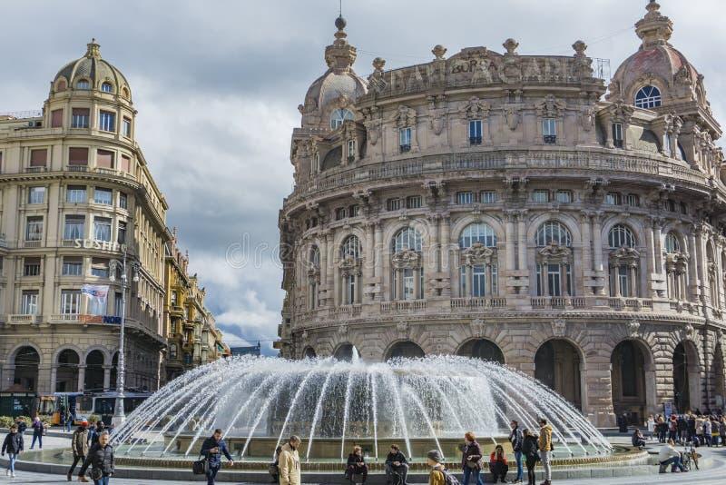 Piazza De Ferrari in Genoa. Unidentified people on the Piazza de Ferrari in Genoa, Italy. Piazza De Ferrari is the main square of Genoa royalty free stock image