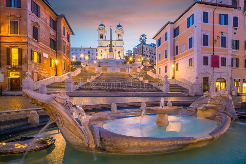 Piazza de spagnaSpanish Steps in rome, italy. At twilight stock images