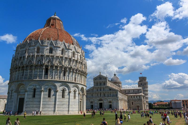 Piazza dei Miracoli with the leaning tower of Pisa, the Cathedral of Santa Maria Assunta and the Baptistery baptistery, Tuscany. The square Piazza dei Miracoli stock images
