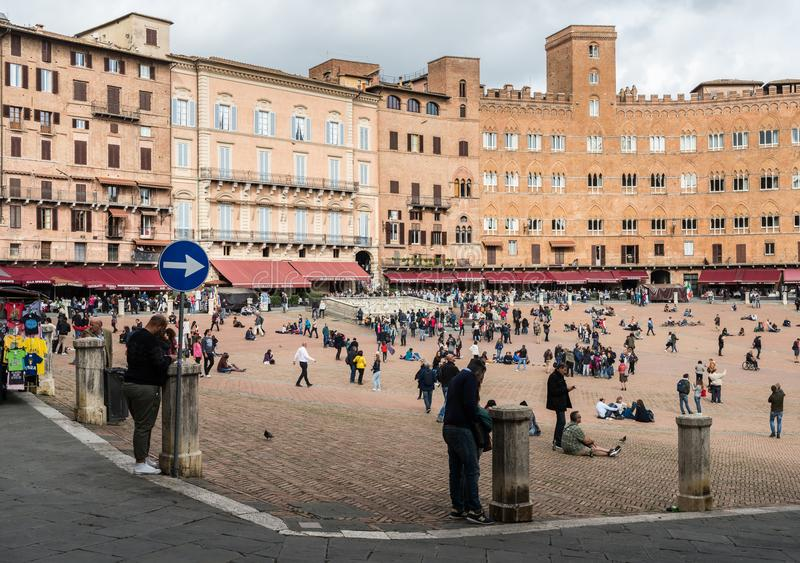 Piazza del Campo and Palazzo Pubblico in Siena, Tuscany,. Siena, Italy - October 29th, 2017: Medieval Piazza del Campo and Palazzo Pubblico in Siena, Tuscany royalty free stock photo