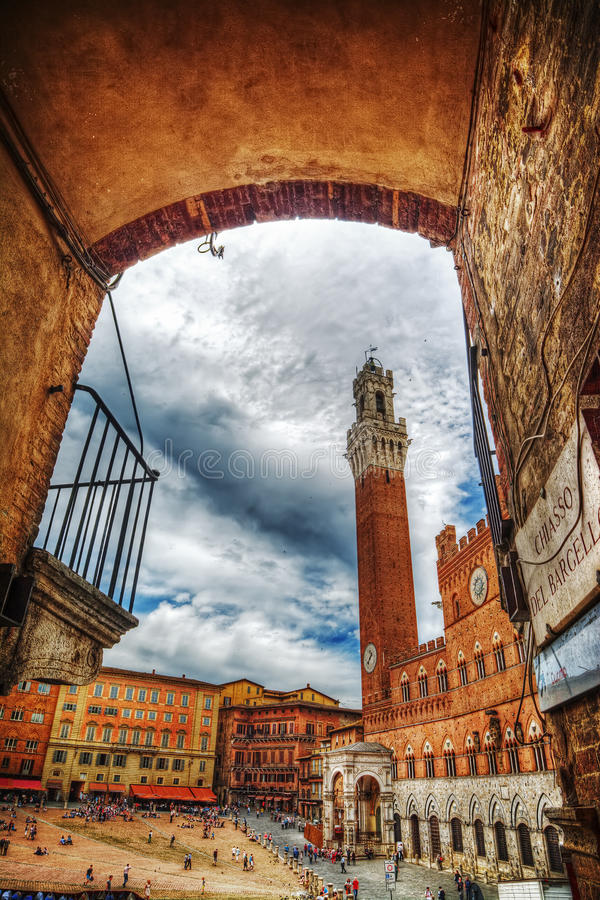 Piazza del Campo in Siena seen from an arch stock photography
