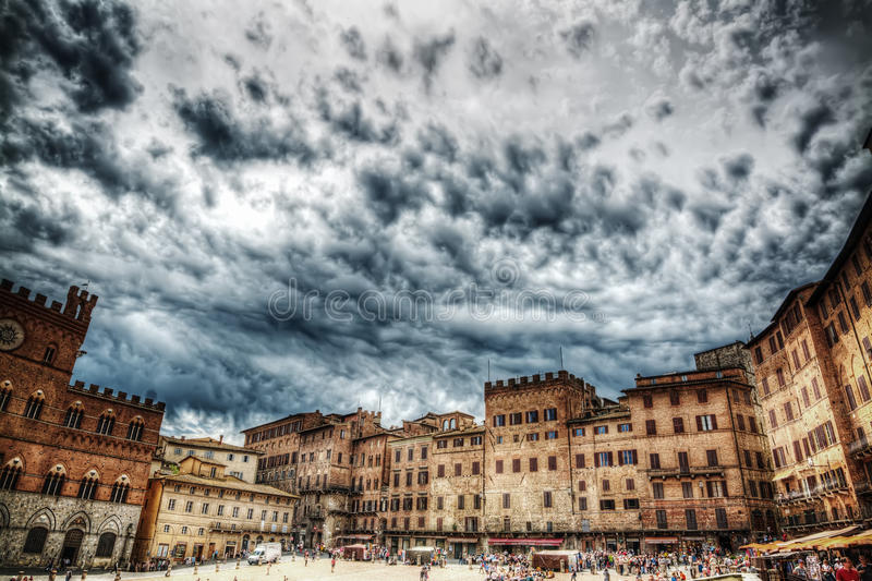 Piazza del Campo in Siena under a dramatic sky in hdr royalty free stock photography