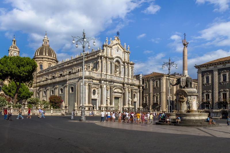 Piazza del Duomo with the Cathedral of Santa Agatha and the Elephant Sculpture Fountain - Catania, Sicily, Italy. CATANIA, ITALY - Jun 18, 2015: Piazza del Duomo stock photo