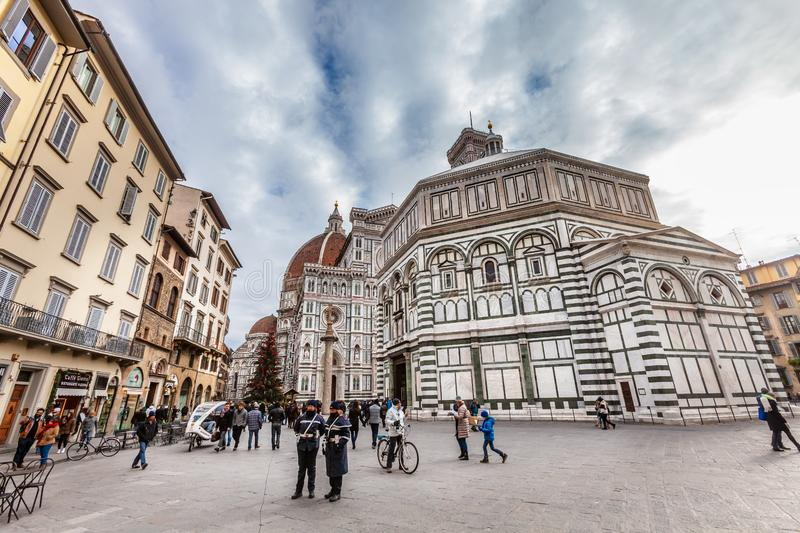 Piazza del Duomo in Florence, baptistery of San Giovanni with many tourists visiting. royalty free stock images
