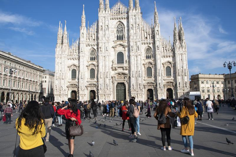 Piazza del Duomo packed with tourists, Milan stock photo