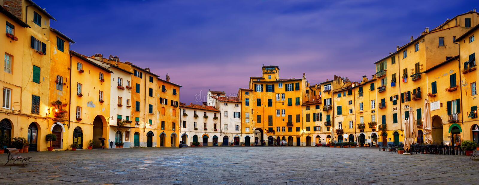 Piazza dell`Anfiteatro old square in Lucca. Tuscany, Italy. Panorama cityscape view stock photography