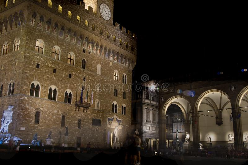 Piazza della Signoria in Florence, Italy at night. Fountain of Neptune and Palazzo Vecchio, aka Ancient Palace royalty free stock image