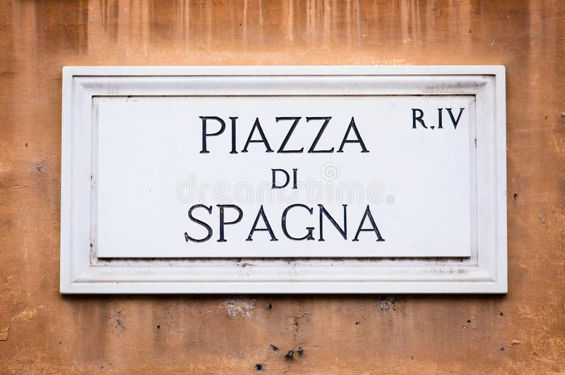 Piazza di Spagna street sign on wall in Rome, Italy stock images