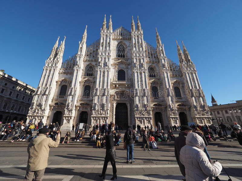 Piazza Duomo Cathedral Square in Milan. MILAN, ITALY - CIRCA JANUARY 2017: Tourists visiting Piazza Duomo meaning Cathedral Square stock images