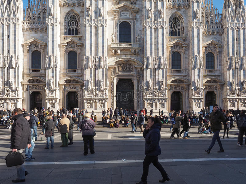 Piazza Duomo Cathedral Square in Milan. MILAN, ITALY - CIRCA JANUARY 2017: Tourists visiting Piazza Duomo meaning Cathedral Square stock photos