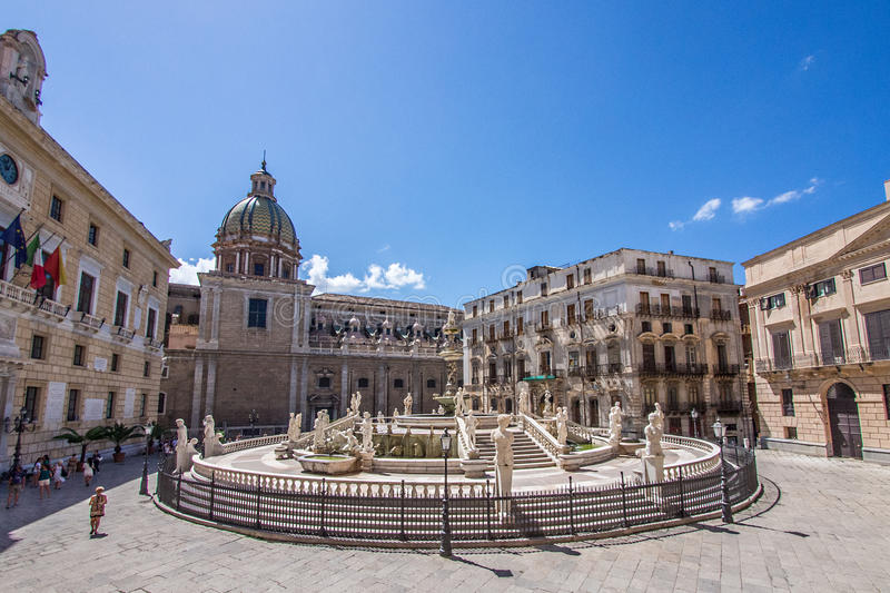 Piazza in Palermo, Italy. Fountain in piazza in Sicilian city of Palermo, Italy on sunny day royalty free stock photos