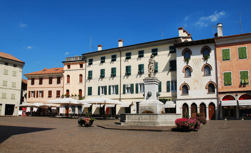 Piazza Paolo Diacono. In the UNESCO World Heritage Centre town of Cividale Del Friuli, Italy. The statue atop the fountain features four lion heads and Diana stock photos