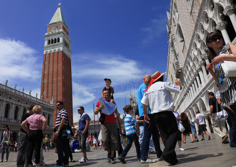 Piazza San Marco. Venice,Italy,July 28th, 2011: Low angle view of people in various situation in St. Marco Square in Venice. Piazza San Marco is the main public royalty free stock images